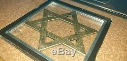 Vintage Judaica item a brass Magen David logo framed in double glass tail rare